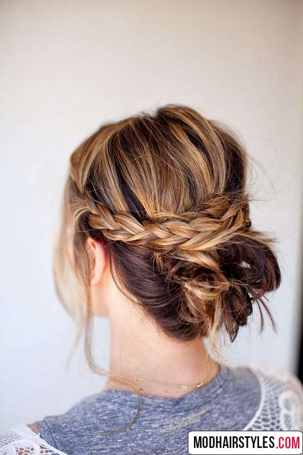 stylish braided messy bun hairstyle